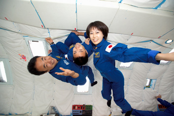 Japanese astronauts in a microgravity flight.