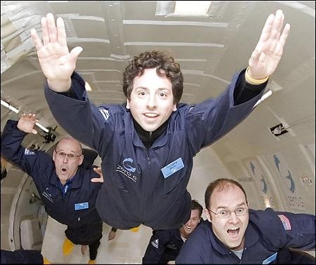 Google Co-founder and billionaut-to-be Sergey Brin (center, full head of hair) floats in microgravity.