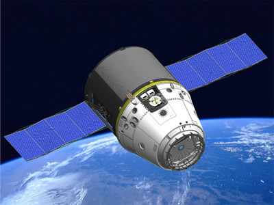 Artists conception of SpaceX\'s Dragon spacecraft in orbit