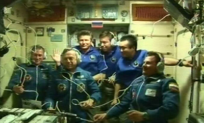Expedition 20 - the first six-strong International Space Station crew - assembled in the Zvezda module for the welcoming ceremony immediately after hatch opening following the arrival of ESA astronaut Frank De Winne, Russian cosmonaut Roman Romanenko and Canadian Space Agency astronaut Robert Thirsk with the Soyuz TMA-15 spacecraft on 29 May 2009. Credit: ESA