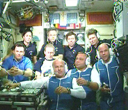 Guy Laliberte (first row, far right) aboard the International Space Station.