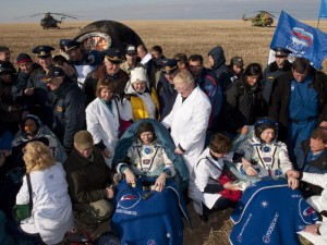 Surrounded by medical personnel, seated from left to right are spaceflight participant Guy Laliberte, Expedition 20 Commander Gennady Padalka and Expedition 20 Flight Engineer Michael Barratt.They had landed minutes before at 12:32 a.m. EDT aboard the Soyuz capsule near the town of Arkalyk, Kazakhstan, on Sunday, Oct. 11, 2009.