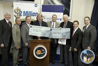L-R: George Nield, Associate Administrator for Commercial Space Transportation, FAA; Charlie Bolden, NASA Administrator; Doug Comstock, Director, Innovative Partnerships Program, NASA; David Masten, CEO, Masten Space Systems; Phil Eaton, VP, Operations, Armadillo Aerospace; Rep. Ralph Hall, Texas, Ranking Member, Science & Technology Committee; Peter Diamandis, Chairman & CEO, X PRIZE Foundation; Mitch Waldman, VP, Advanced Programs & Technology, Northrop Grumman