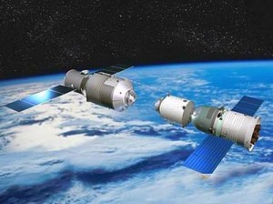 China's Tiangong-1 space laboratory with a Shenzhou spacecraft approaching it. (Credit: CNSA)