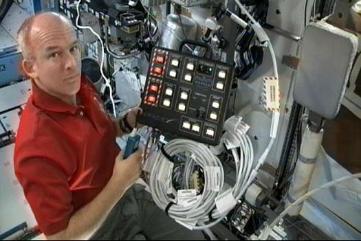 Astronaut Jeff Williams, Expedition 22 Commander, aboard the International Space Station with the SpaceX-developed controller for the Dragon spacecraft communications system. Credit: NASA