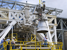 An AJ26 engine on a test stand at NASA Stennis.