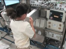 Astronaut Shannon Walker activates an experiment aboard the International Space Station. Image credit: NASA