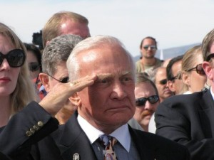 Buzz Aldrin salutes during the singing of the National Anthem at the Spaceport America runway dedication.