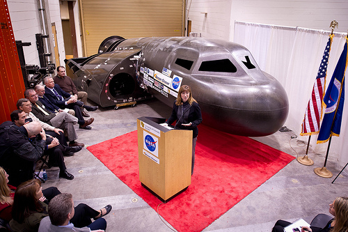 NASA Deputy Administrator Lori Garver talks during a press conference with Sierra Nevada's Dream Chaser spacecraft in the background on Saturday, Feb. 5, 2011, at the University of Colorado at Boulder.  Sierra Nevada's Dream Chaser spacecraft is under development with support from NASA's Commercial Crew Development Program to provide crew transportation to and from low Earth orbit. Photo Credit: (NASA/Bill Ingalls)