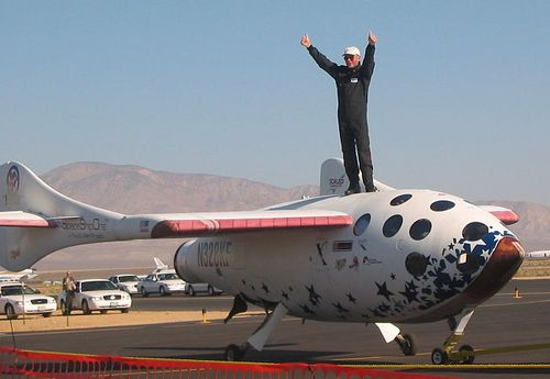 Mike Melvill stands atop SpaceShipOne after a suborbital flight on Sept. 29, 2004. (Credit: RenegadeAven)