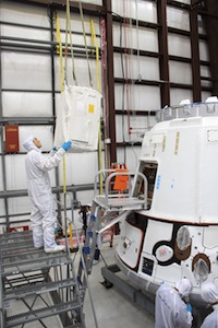 Image above: A technician guides a cargo bag into the Dragon spacecraft at the SpaceX facility at Cape Canaveral Air Force Station, Fla. (Credit: NASA/Jim Grossmann)