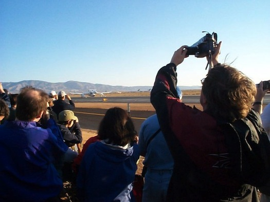 WhiteKnight with SpaceShipOne on the taxiway prior to the first commercial spaceflight. I'm on the right filming. To my left, Eric Dahlstrom and Emeline Paat-Dahlstrom. (Credit: John Criswick)