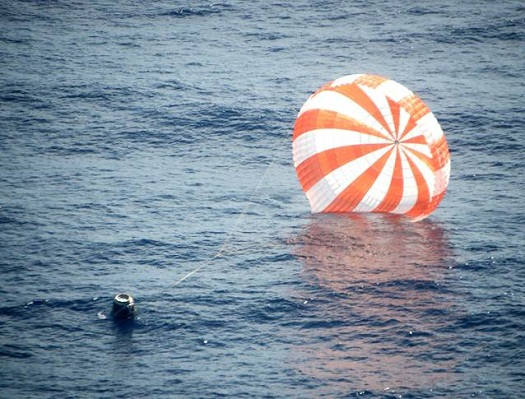 The Dragon CRS-1 capsule after landing safely in the Pacific. (Credit: SpaceX)