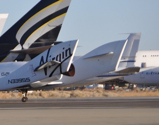 A rocket nozzle with a round pipe in the middle of it is shown in this image of SpaceShipTwo after it completed an unpowered glide flight on Dec. 19, 2012. (Credit: Bill Deaver)