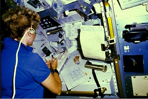 UCSF's Millie Hughes-Fulford collects blood as part of her duties as a NASA astronaut conducting biomedical studies in space. (Credit: NASA)