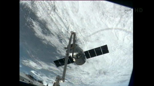 Dragon captured at ISS. (Credit: NASA TV)