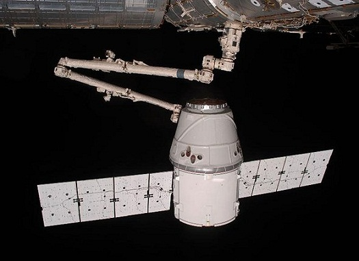 View from the International Space Station of the SpaceX Dragon spacecraft as the robotic arm moves Dragon into place for attachment to the station May 25, 2012. (Credit: NASA)