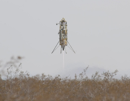 Masten's Xombie space-access technology demonstrator descends for landing after its highest and longest flight to date, guided by Draper Lab's GENIE navigation and control system. (Credit: NASA/Tom Tschida)