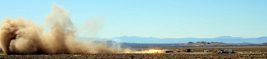 RocketMotorTwo kicks up some dust during a hot fire on March 30, 2013. (Credit: Virgin Galactic)