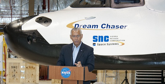 NASA Administrator Charlie Bolden discusses the role and capabilities of Sierra Nevada Corporation (SNC) Space Systems' Dream Chaser flight vehicle for eventual transport of astronauts to and from the International Space Station with assembled news media representatives during a briefing at NASA's Dryden Flight Research Center. (Credit: NASA/Ken Ulbrich)