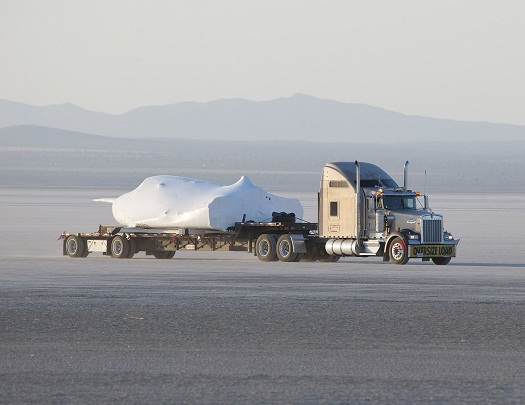 SNC's Dream Chaser test flight craft is hauled across the bed of Rogers Dry Lake at Edwards Air Force Base, Calif., to NASA's Dryden Flight Research Center on May 15. (Credit: NASA/Tom Tschida)