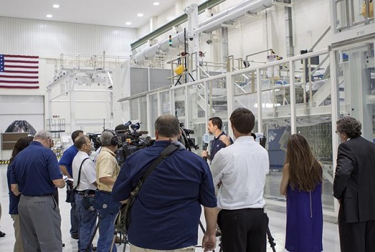 Jeremy Parsons, chief of the GSDO Operations Integration Office at Kennedy Space Center, speaks to the media during a tri-program briefing in the Operations and Checkout Building high bay on June 27. (Credit:  NASA/Jim Grossman)