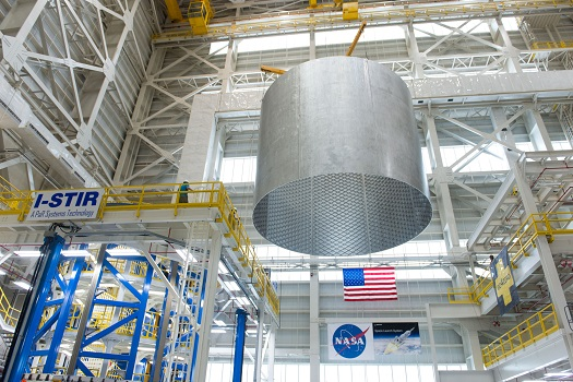 Engineers at NASA's Michoud Assembly Facility transfer a 22-foot-tall barrel section of the SLS core stage from the Vertical Weld Center. (Credit: NASA)