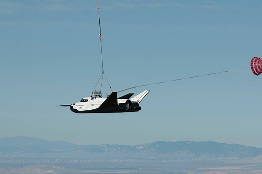 Dream Chaser in a captive carry flight over the Mojave. (Credit: Sierra Nevada Corporation