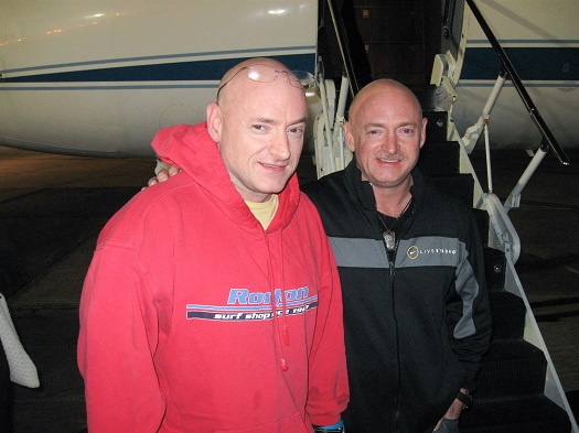 Expedition 26 Commander Scott Kelly (left), is reunited with twin brother, Mark Kelly on March 17, 2011, following a flight to Ellington Field in Houston from Kustanay, Kazakhstan after 159 days in space, 157 days on the International Space Station. (Credit:  NASA)