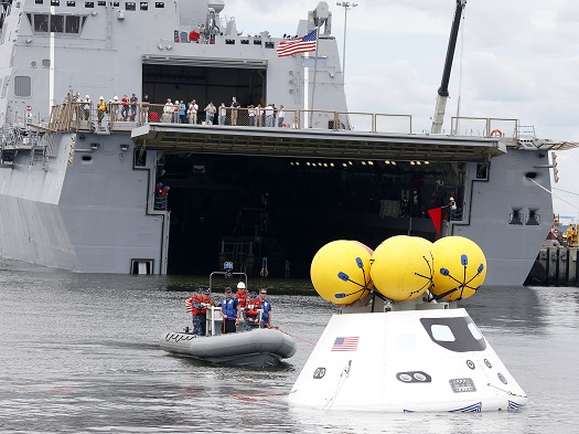 During the stationary recovery test of Orion at Norfolk Naval Base, divers attached tow lines and led the test capsule to a flooded well deck. Image Credit: NASA/Dave Bowman