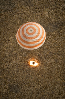 The Soyuz TMA-08M spacecraft with Expedition 36 Commander Pavel Vinogradov of the Russian Federal Space Agency (Roscosmos), Flight Engineer Alexander Misurkin of Roscosmos and Flight Engineer Chris Cassidy of NASA aboard, lands in a remote area near the town of Dzhezkazgan, Kazakhstan. (Credit:  NASA/Bill Ingalls)
