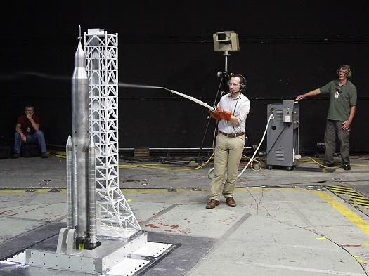 During the liftoff transition testing of a nearly six-foot model of the Space Launch System, engineers used a technique for studying airflow streamlines called smoke flow visualization, giving them insight into the data retrieved. (Credit:  NASA/LaRC)