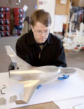 Engineer Mark Street assembles a sub-sonic wind tunnel model Lynx, which was used at the U.S. Air Force test facility at Wright-Patterson Air Force Base near Dayton, Ohio. (Credit: XCOR)
