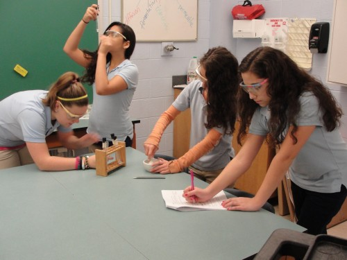 Students at Howard Phifer Middle School from Pennasauken, NJ, complete their proposal for the Effects of Microgravity on Eggshells and Vinegar. (Credit: NCESSE)