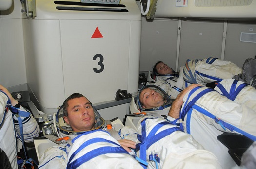 Cosmonauts in a mockup of Russia's next generation crew vehicle. (Credit: Energia)