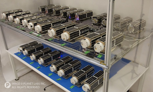 The 28 Flock 1 satellites before being sent to the launch site. (Credit: Planet Labs)
