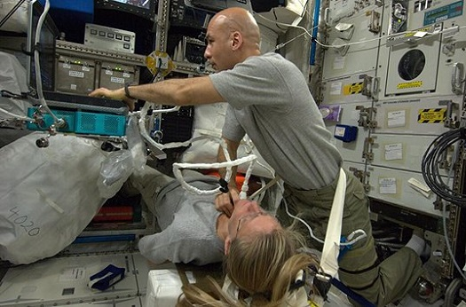 In this photo posted on Twitter by NASA astronaut Karen Nyberg, she undergoes a spinal ultrasound scan conducted by European Space Agency astronaut Luca Parmitano. (Credit: NASA)