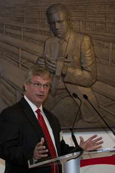 Mark Armstrong speaks at UC in front of the bas-relief depicting his father Neil Armstrong on campus. (Credit: University of Cincinnati)