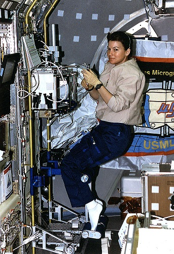 NASA astronaut Cady Coleman supports a protein crystal growth study aboard STS-73 in the Spacelab module in 1995. (Credit: NASA)