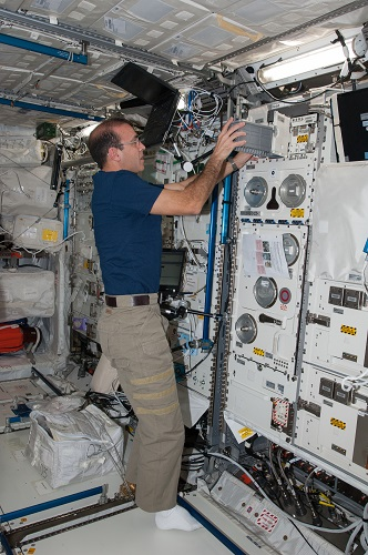 NASA astronaut Rick Mastracchio works with BioLab hardware. BioLab is used to perform space biology experiments on microorganisms, cells, tissue cultures, plants and small invertebrates.(Credit: NASA)