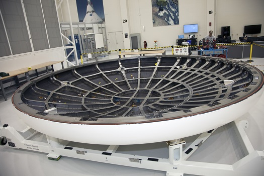 The heat shield for the Orion spacecraft has been placed on a work stand inside the Operations and Checkout Building high bay at NASA's Kennedy Space Center in Florida. (Credit: NASA/Mike Chambers)