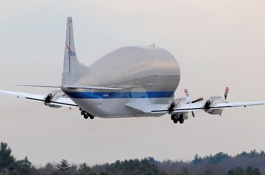 NASA's Super Guppy aircraft takes off from Manchester, N.H., carrying the heat shield that will protect Orion on its first mission, Exploration Flight Test-1, to Kennedy Space Center for installation. (Credit: NASA)