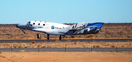 Sporting some shiny new tail booms, SpaceShipTwo touches down at the Mojave Air and Space Port after a glide flight. (Credit: Virgin Galactic)