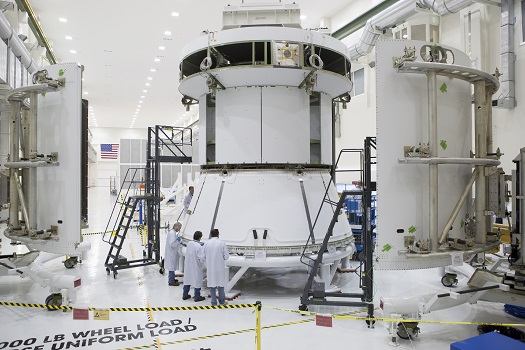 Engineers prepare Orion's service module for installation of the fairings that will protect it during launch this fall when Orion launches on its first mission. The service module, along with its fairings, is now complete. (Credit: NASA)