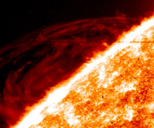 The fine detail in images of prominences in the sun's atmosphere from NASA's Interface Region Imaging Spectrometer – such as the red swirls shown here – are challenging the way scientists understand such events. (Credit:  NASA/LMSAL/IRIS)