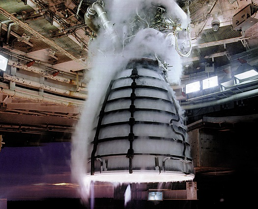 Four RS-25 engines, like the one pictured undergoing a hot-fire test, will power the core stage of NASA's Space Launch System (SLS) -- NASA's new heavy-lift launch vehicle. (Credit: NASA)