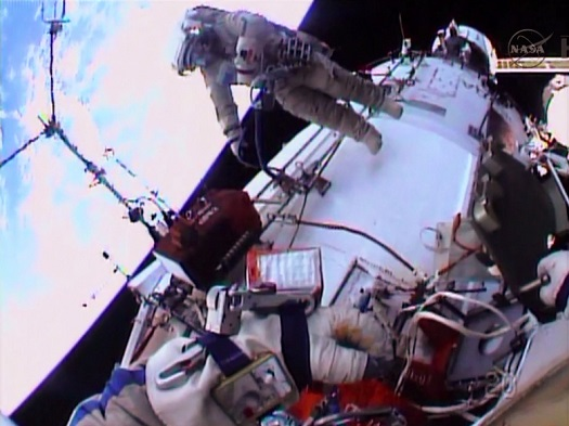 Spacewalker Oleg Kotov works outside the Zvezda service module. (Credit: NASA TV)