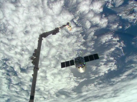 Orbital Sciences' Cygnus cargo craft moves away from the International Space Station's robotic arm shortly after its release. (Credit: NASA TV)