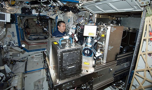 JAXA astronaut Koichi Wakata works on the Combustion Integrated Rack (CIR) in the Destiny laboratory of the International Space Station. (Credit: NASA)