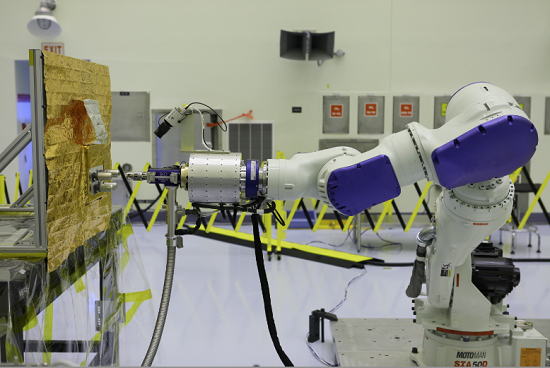 Located at Kennedy but commanded from Goddard, the RROxiTT industrial robot mimics how future space robots could transfer oxidizer to satellites that were not designed to be serviced. (Credit: NASA/KSC)